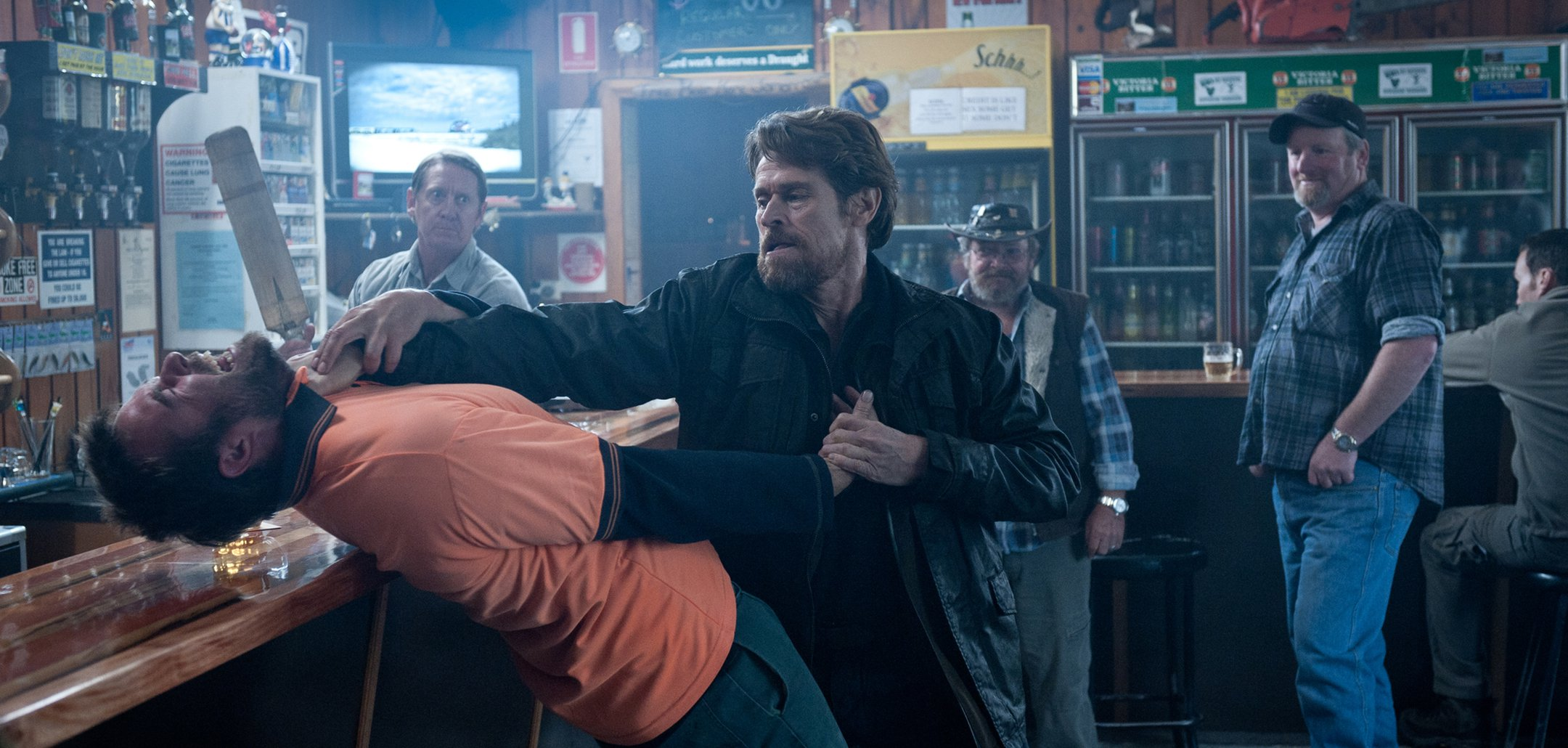 Willem Dafoe involved in a bar fight in a still from 'The Hunter' (2011)