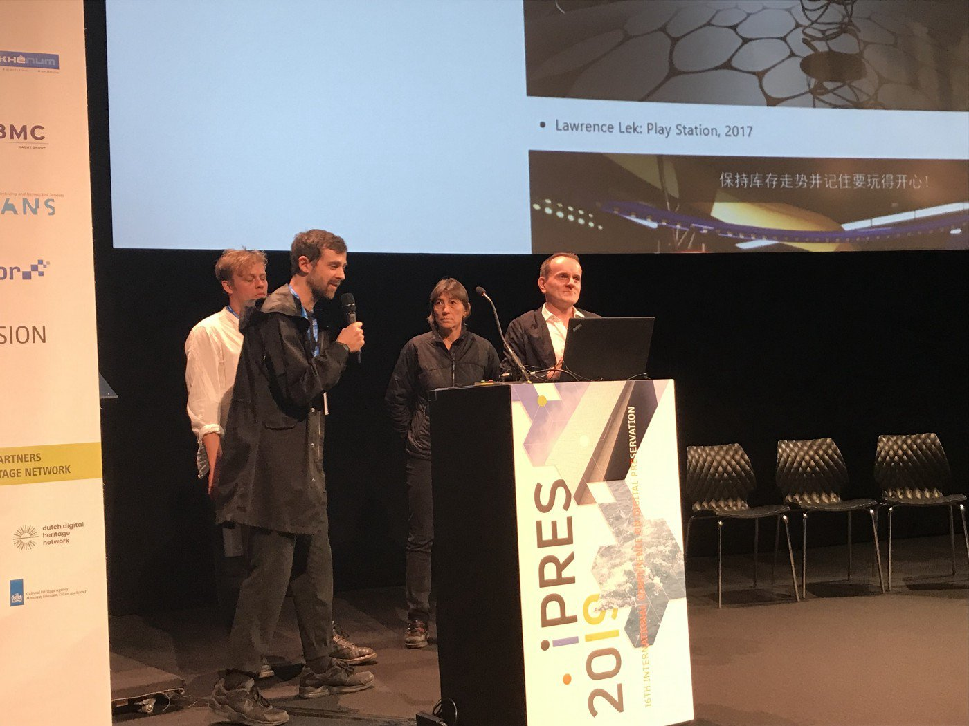 Tom Ensom, Jack McConchie, Claudia Roeck and Dragan Espenschied present some of the VR hackathon findings at iPres 2019