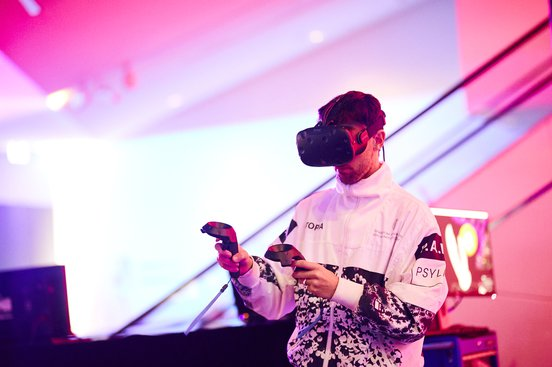 Audience Lab image - man using a VR headset and controllers