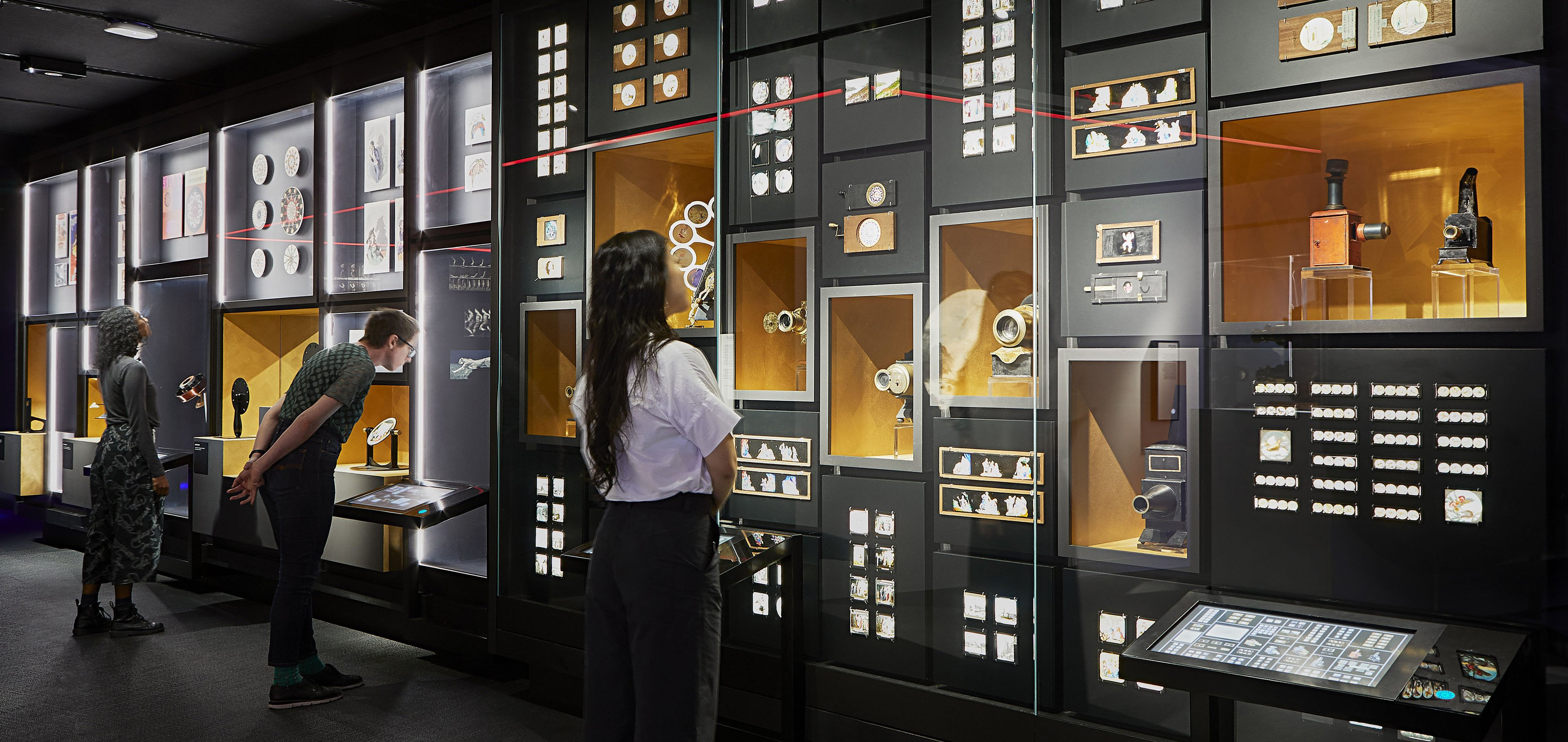Wall of vintage cameras and slides in the Moving Pictures section of The Story of the Moving Image (image credit: Shannon McGrath)