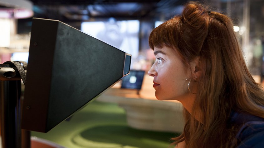 Woman peering into a viewfinder