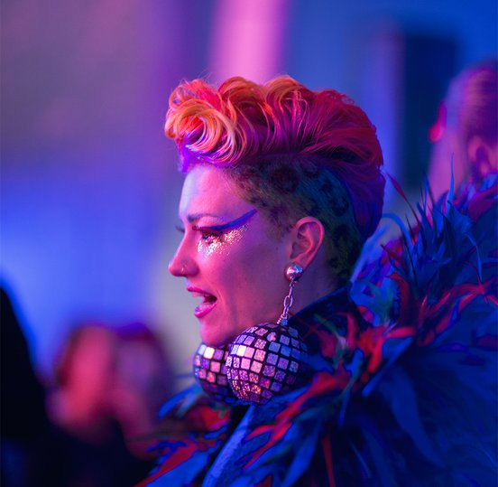 Woman with disco ball earrings at Wonderland Late Nights- photo by Field Carr.jpg