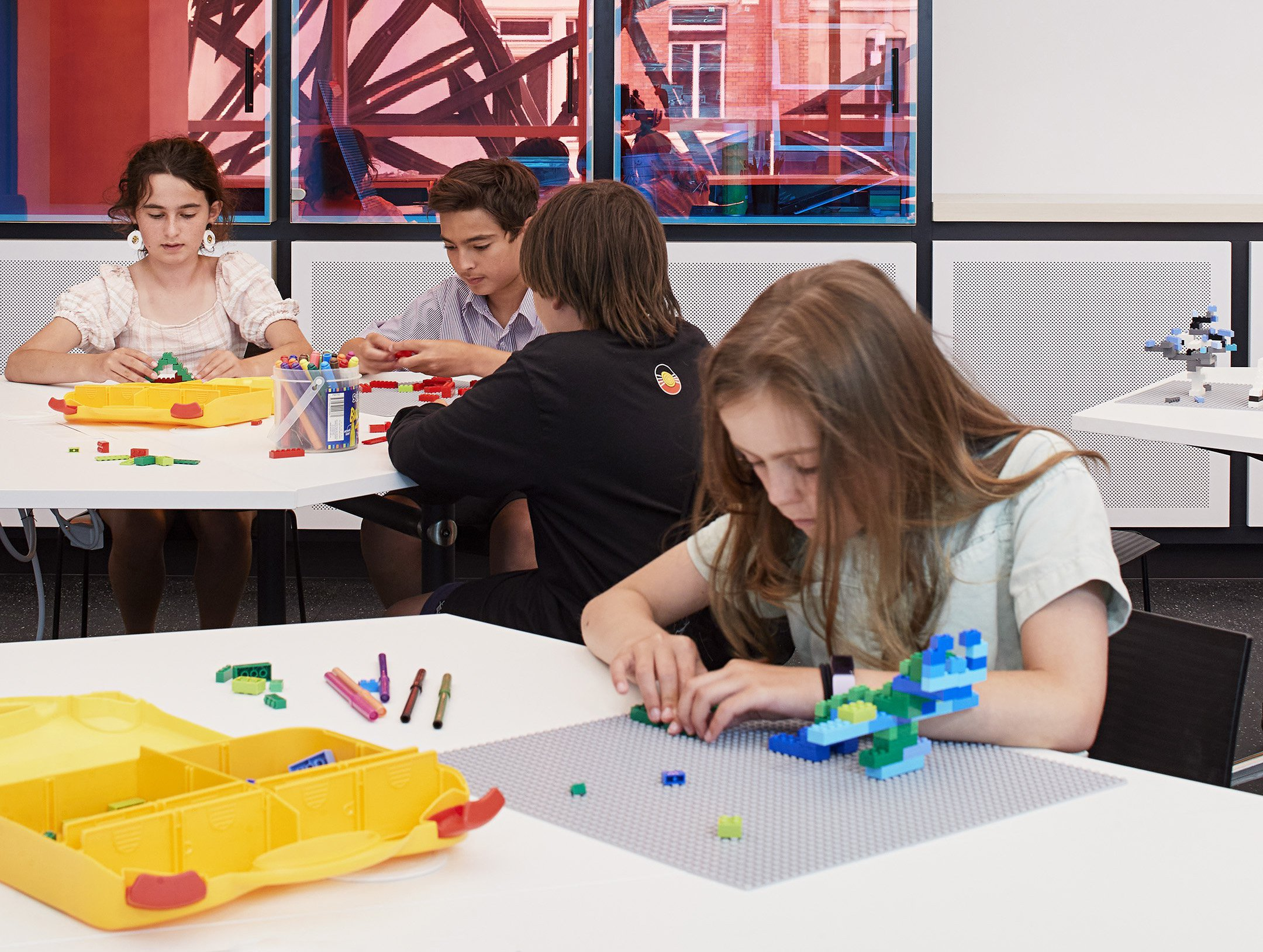 Young kids participating in stop motion building block activities in ACMI's Gandel Digital Future Lab