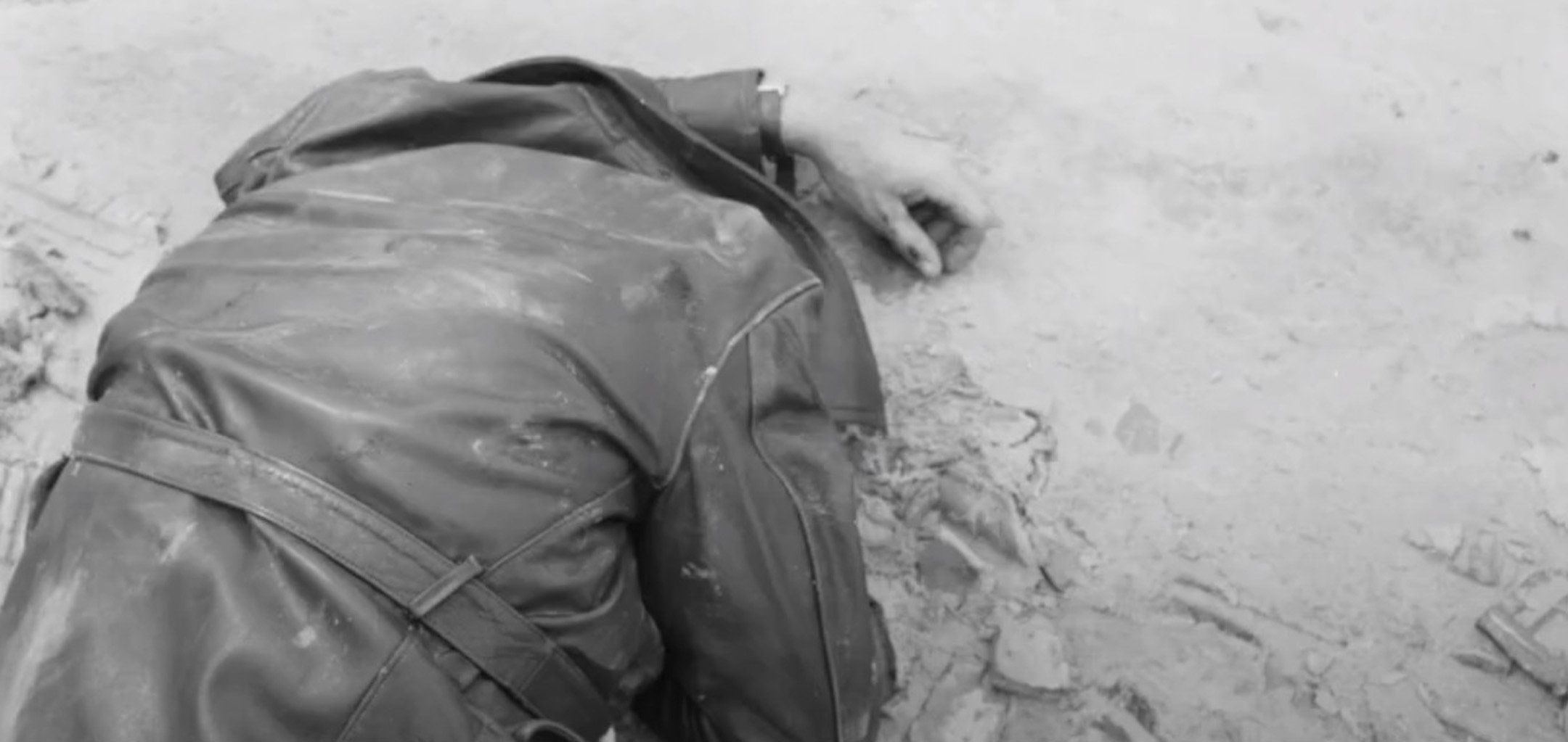Dead man - still from 'head_phone_film_poems' by Ross Gibson