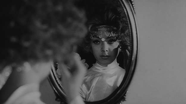 A still from Funeral Parade of Roses - looking in the mirror
