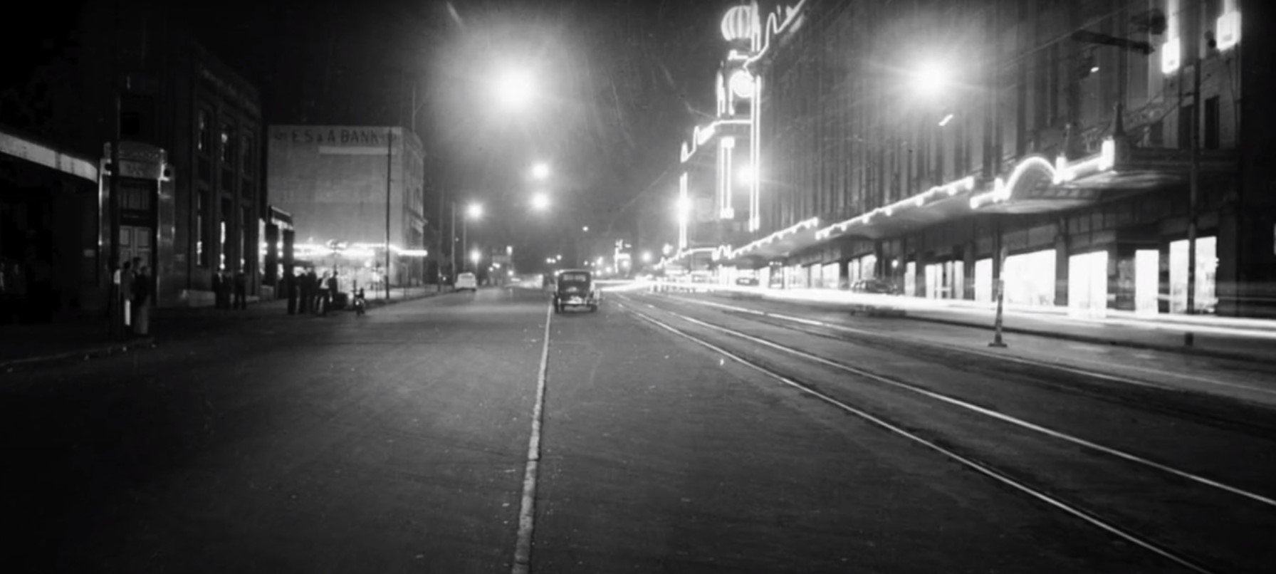 A streetscape at night in the mid twentieth century - still from 'head_phone_film_poems' by Ross Gibson