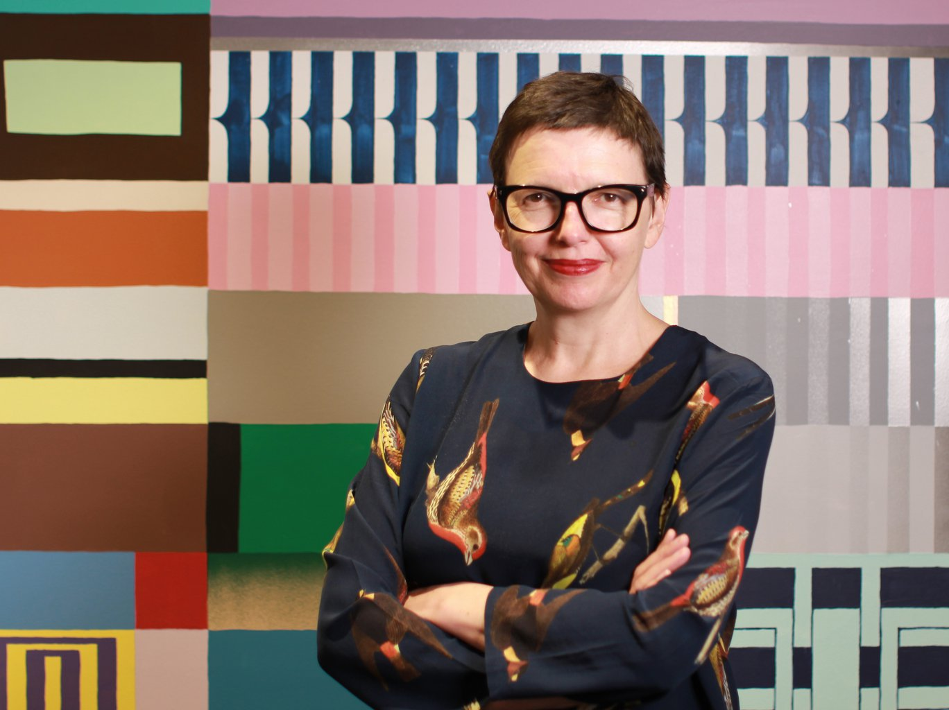 Katrina standing in front of a patterned colourful wall