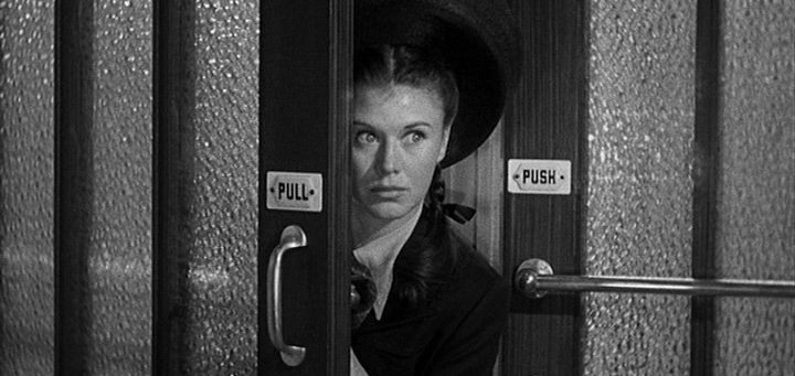 Ginger Rogers peering from behind a door in The Major and the Minor (1942)