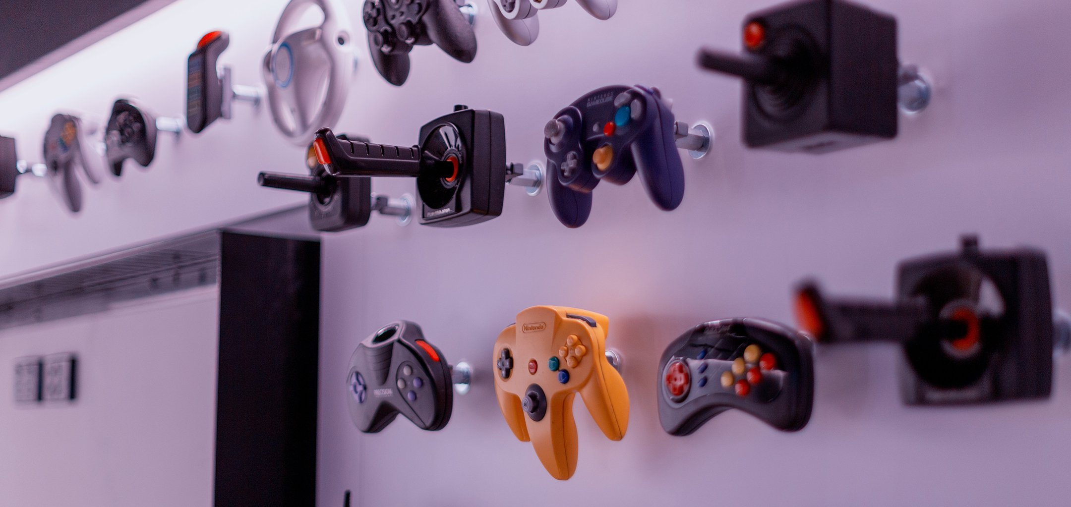 Wall of videogame controllers at ACMI