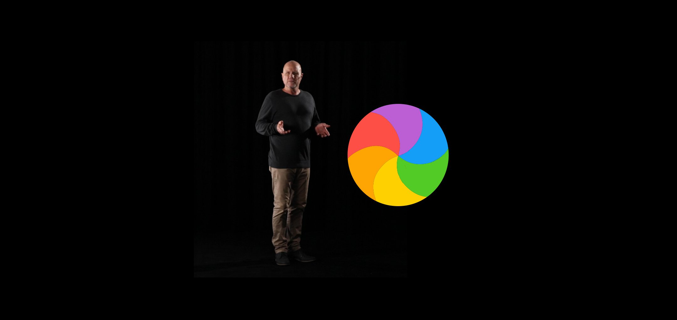 Actor Todd Levi as featured in the immersive experience 'For Those Who Wait', standing in a black void next to a multi-coloured circle