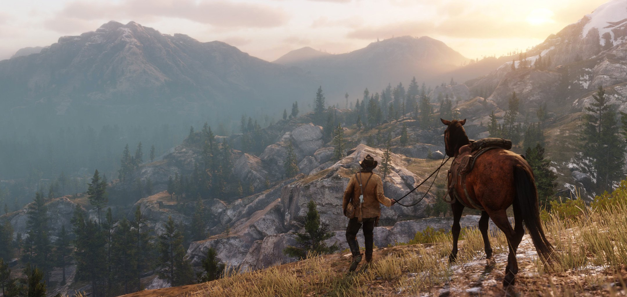 Arthur Morgan leads his horse across a dramatic landscape in a screenshot from 'Red Dead Redemption 2' (2018) Rockstar Games.jpg